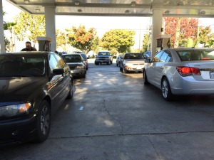 Drivers wait in long lines for best gas prices.