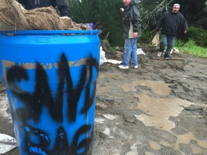 Residents of Pacifica load sandbags.  Threat of flooding forces home & business owners to act quickly.