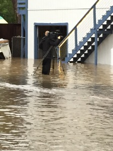 my colleague Steve Stifter @kgocameraman - wading through 3 feet of flood water for the perfect shot - Weather Stories require commitment! Guerneville Residents keeping an eye on the river's swollen banks. Friday, December 12th 2014