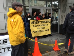protesters block entrances to Oakland Police Department headquarters  Monday, December 15th, 2014