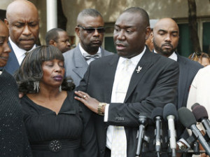 Benjamin Crump, right, a lawyer, with Jannie Ligons, one of the victims of sexual assault by Daniel Holtzclaw, during a news conference outside the Oklahoma City courthouse. Credit Sue Ogrocki/Associated Press