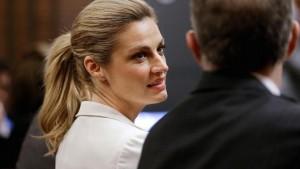 Sportscaster and television host Erin Andrews, left, talks with her attorney, Randy Kinnard, in Nashville, Tenn. Mark Humphrey | AP
