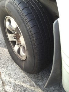 I can see what is believed to be a nail sticking from my tire. #curses